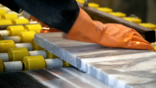 worker is holding marble in production line in marble factory - granite stock videos & royalty-free footage