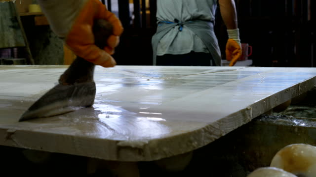 Worker is polishing marble  in marble factory