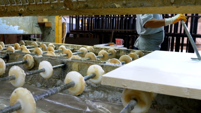 Worker is waiting marble in production line in marble factory