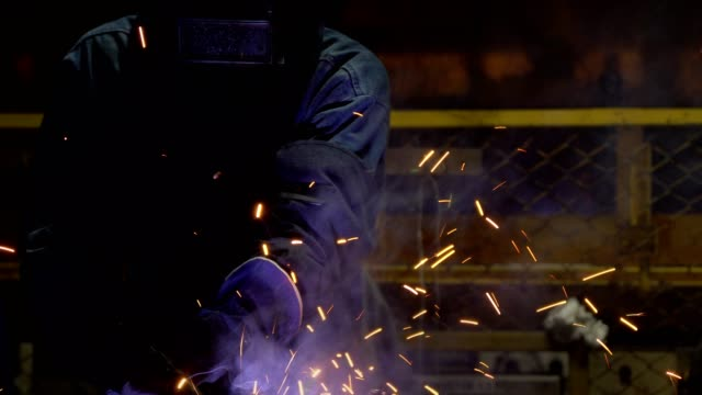 worker is welding automotive part in car factory - welding stock videos & royalty-free footage