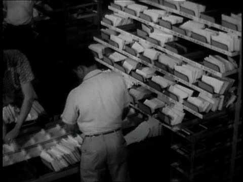 1957 ms worker loading trays of mail / united states - 1957 stock videos & royalty-free footage