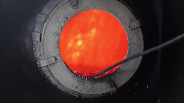 stockvideo's en b-roll-footage met worker loads metal bars into a furnace at a sargam metals ltd aluminum recycling facility in chennai, tamil nadu, india, on thursday, feb 25 a worker... - hoogoven