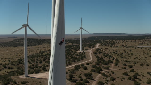 Worker Lowering down Turbine from ropes