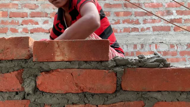worker making a brick wall of a building house in a construction site of a non urban residential area. on february 18, 2021 in barpeta, india. the... - stone material stock videos & royalty-free footage