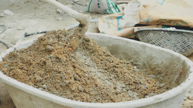 worker making cement mix with water for building construction - cement mixer stock videos & royalty-free footage