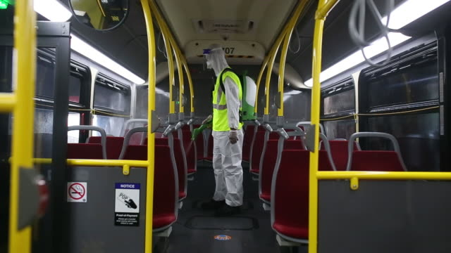 ttc worker milan kerai cleans a toronto transit commission bus the ttc carried about 17 million passengers per day prior to the coronavirus pandemic... - spraying stock videos & royalty-free footage