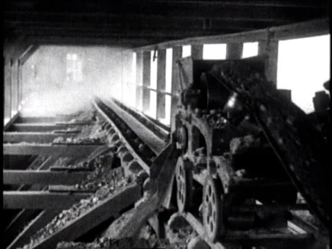 1930 ws worker mining/processing silver ore with a machine on a train track / mexico city, mexico - metal ore stock videos & royalty-free footage