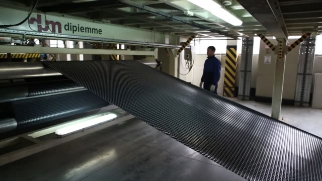 A worker monitors computers operating a rolling machine on the production line at the Technoplex manufacturing plant operated by TechnoNicol Corp in...