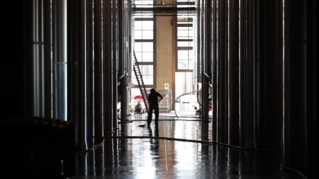 Worker mops floor at Septima winery