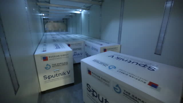 worker moving boxes of sputnik v covid-19 vaccine, developed by gamaleya national research center for epidemiology and microbiology and russian... - moscow russia video stock e b–roll