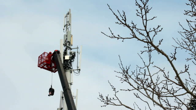 worker on crane fixing cell tower - pole stock videos & royalty-free footage