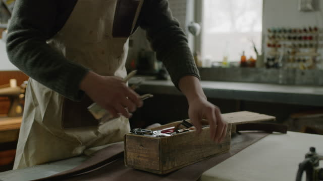 worker opening wooden box in workshop and searching for tool / provo, utah, united states - provo video stock e b–roll
