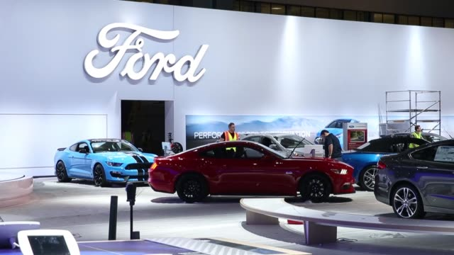 a worker operates a lift past ford motor co signage in the company's booth during preparations for automobility la ahead of the los angeles auto show... - motor show stock videos and b-roll footage