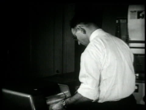 1948 montage worker operating an early version of the fax machine / united states - fax machine stock videos & royalty-free footage