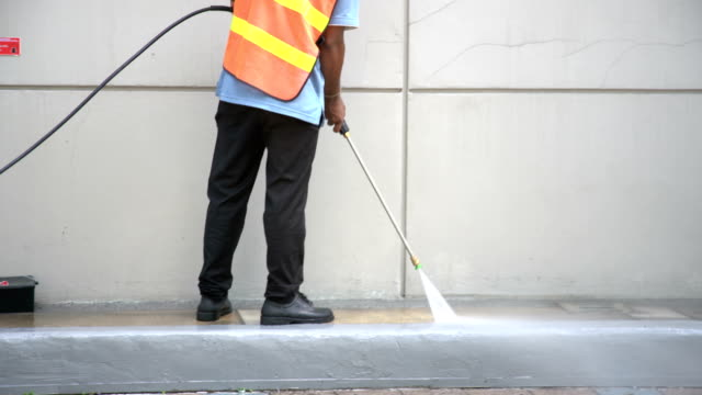 worker or cleaning staff is using a high-pressure water spray - high up stock videos & royalty-free footage