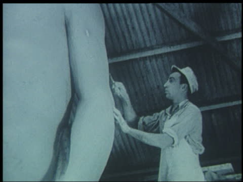 b/w 1939 worker painting arm of large statue for world's fair - one mid adult man only stock videos & royalty-free footage