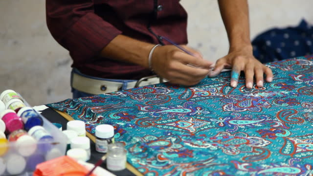 Worker painting on the clothes, Noida, Uttar Pradesh, India