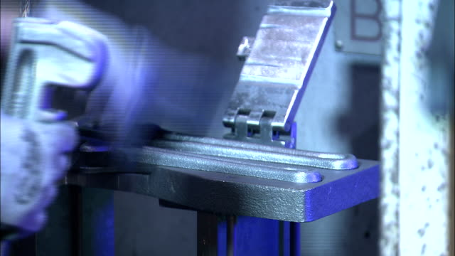 a worker places wrenches into a vice. - schraubstock stock-videos und b-roll-filmmaterial
