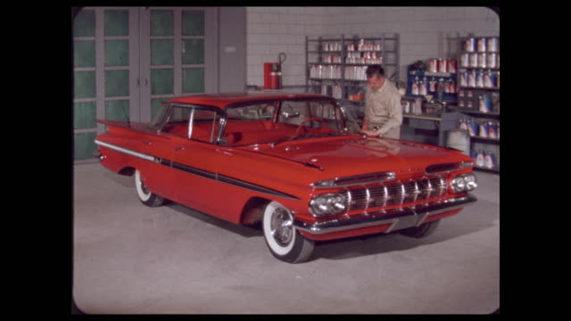 worker polishes window of 1960s auto in paint shop - polishing stock videos & royalty-free footage