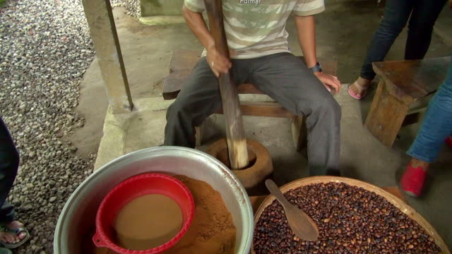 worker pounding coffee beans - indonesia stock videos & royalty-free footage