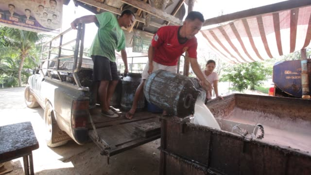 Worker pours fresh rubber milk into a filtering bath at his home in Ban Kokpayom village Songklha province Thailand on Monday May 18 2015 Shots man...