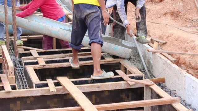 worker prepare site for reinforcement metal formwork for concrete pouring - condition stock videos & royalty-free footage