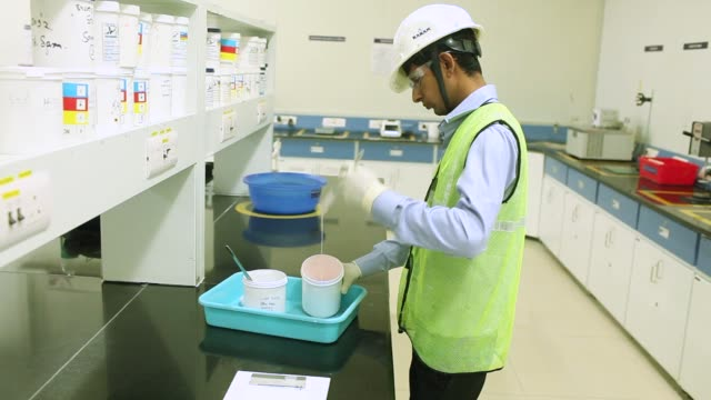a worker prepares paint for a spread test in a laboratory at an akzo nobel india ltd paint factory in gwalior madhya pradesh india on thursday june 1... - madhya pradesh stock videos and b-roll footage