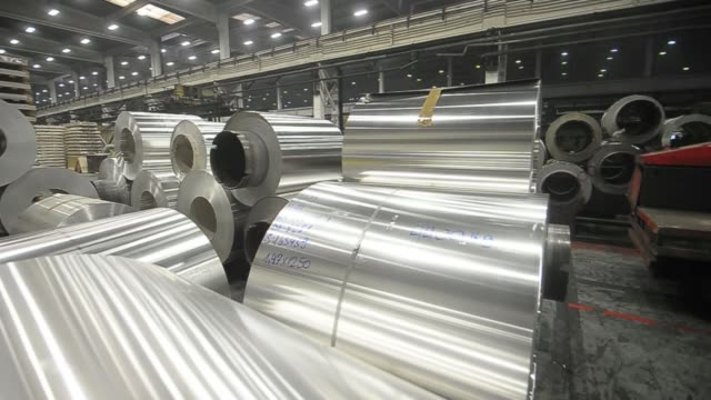 vidéos et rushes de worker prepares rolls of sheet aluminum for shipping at the impol seval ad plant in sevojno, serbia, on wednesday, oct. 9 a worker uses a fork lift... - serbia