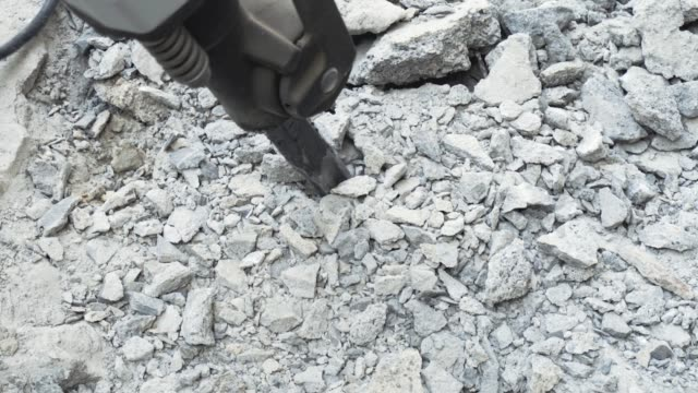 worker preparing construction site. - stone material stock videos & royalty-free footage