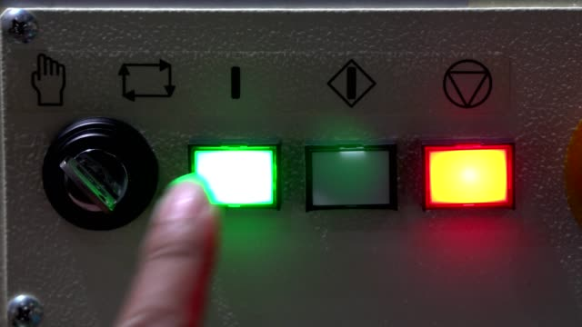 worker pushing button to start automatic machine. - control panel stock videos & royalty-free footage