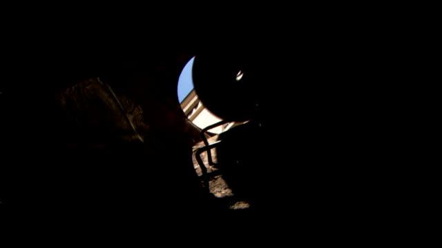 vídeos y material grabado en eventos de stock de a worker removes a manhole cover and allows a visitor to enter the sewer system. - tapadera de cloaca