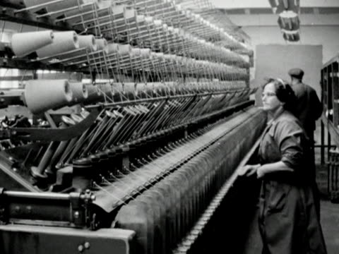 a worker removes full bobbins of wool from a machine in a wool mill - ball of wool stock videos & royalty-free footage