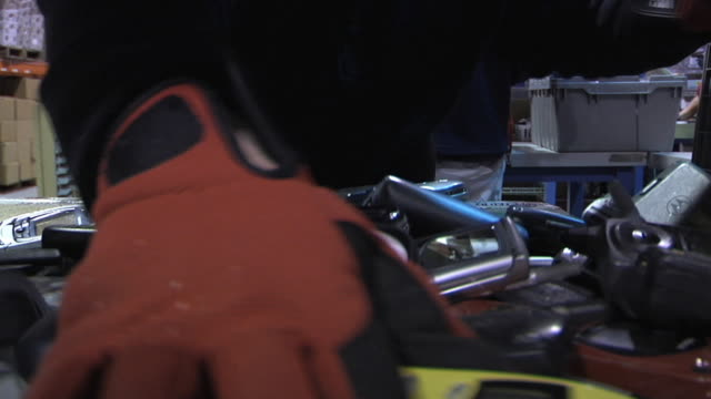 cu worker removing batteries from used cell phones that come to facility for refurbishing or recycling / dexter, michigan, usa - electronics industry stock videos & royalty-free footage