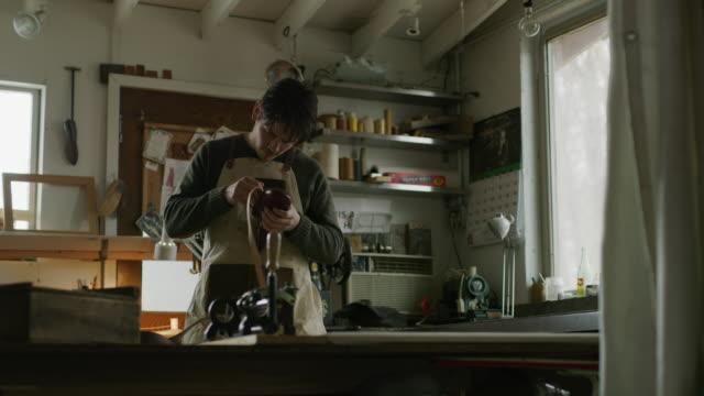 worker repairing shoe then stopping in frustration / provo, utah, united states - vårdslös bildbanksvideor och videomaterial från bakom kulisserna