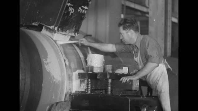 worker slathering maybe paint with brush on slowly revolving gun barrel / gun barrel, can of maybe paint to side; worker's hand enters with brush and... - gun barrel stock videos & royalty-free footage