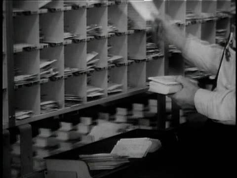 1957 ms worker sorting mail / united states - postamt stock-videos und b-roll-filmmaterial