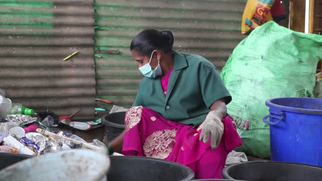 A worker sorts plastic household waste at a warehouse in a recycling facility operated by Mysuru City Corp in Mysuru Karnataka India on Tuesday Nov...