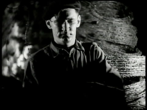 worker spoling barbed wire onto roll. rolls of barbed wire stacked bg. spool of barbed wire turning. - anno 1935 video stock e b–roll