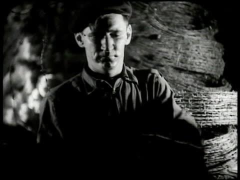 vídeos y material grabado en eventos de stock de worker spoling barbed wire onto roll. rolls of barbed wire stacked bg. spool of barbed wire turning. - 1935