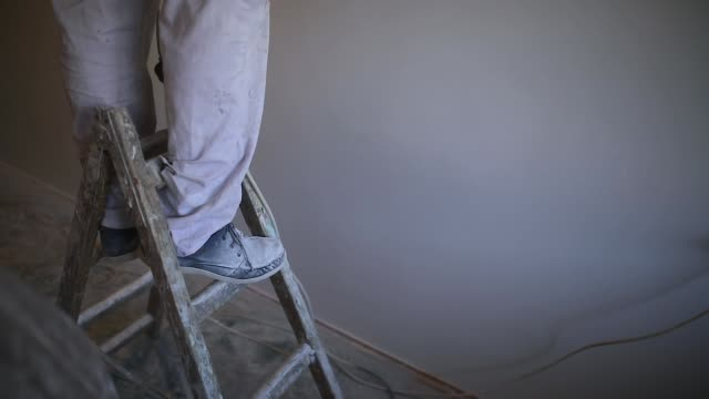 worker standing on a ladder - ladder stock videos & royalty-free footage