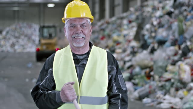 slo mo worker sweeping the floor in a recycling facility - moustache stock videos and b-roll footage