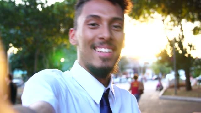 worker taking a selfie after work - pardo brazilian stock videos & royalty-free footage