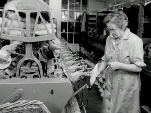 a worker threads a wool bobbin onto a machine at a wool mill - ball of wool stock videos & royalty-free footage