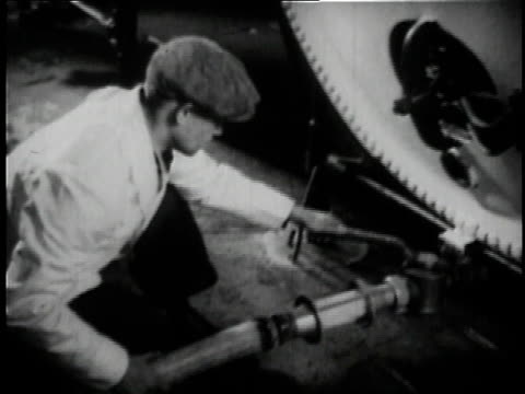 1936 worker turning lever on pipe at Anheuser Busch brewery in St. Louis / Missouri, United States