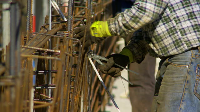 worker tying the rebar on constrution site cu - girder stock videos & royalty-free footage