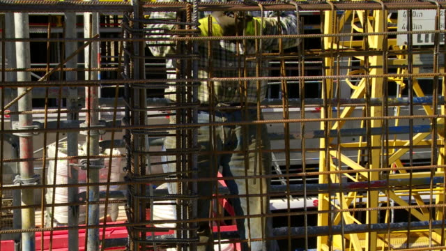 worker tying the rebar on constrution site cu - rod stock videos and b-roll footage