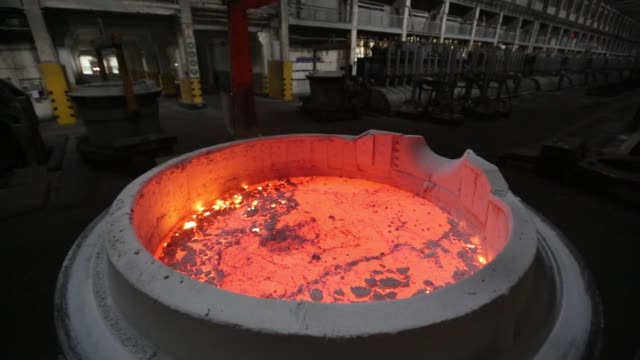 a worker uncovers a cauldron of liquid electrolyte inside the electrolysis shop at the krasnoyarsk aluminum smelter operated by united co rusal in... - aluminium stock videos & royalty-free footage