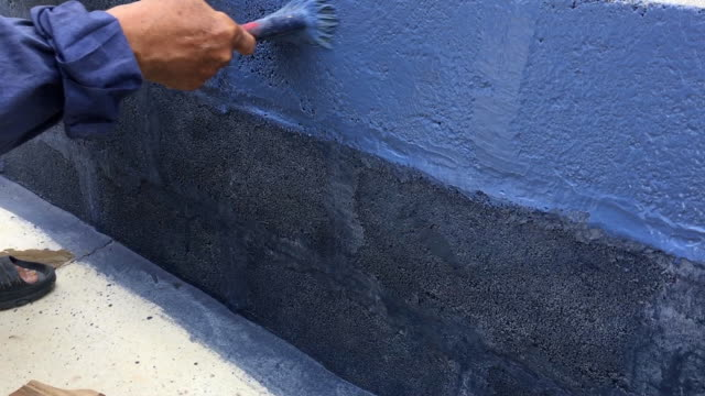 worker use brush for color paint on concrete wall - concrete wall stock videos & royalty-free footage