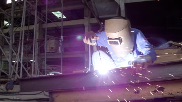 worker use welding machine - manufacturing occupation stock videos and b-roll footage
