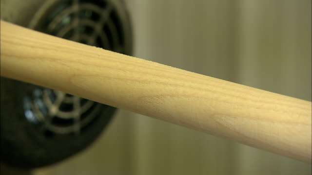 a worker uses a caliper to measure the width of a wooden baseball bat. - calliper stock videos and b-roll footage
